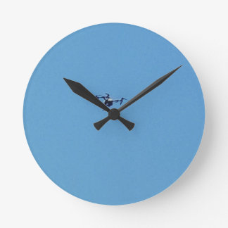 Hoovering Droid Against Blue Sky Simplicity Round Clock