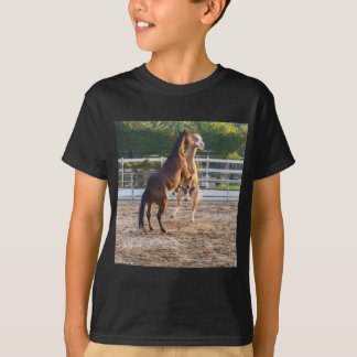 Horese in a playful mood t shirts