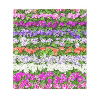 Horizontal rows of various colored flowers notepads