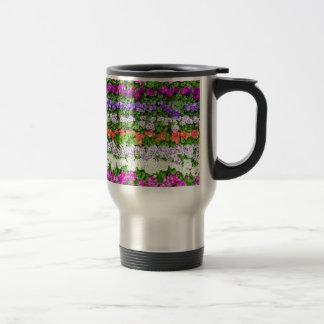 Horizontal rows of various colored flowers travel mug