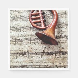 Horn ornament on music paper napkins