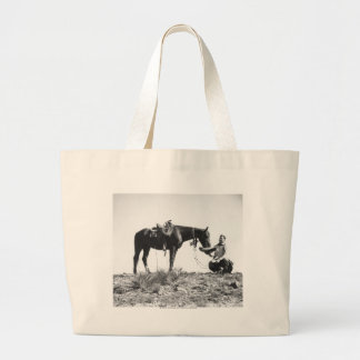 Horse eating from a cowboy's hat. jumbo tote bag