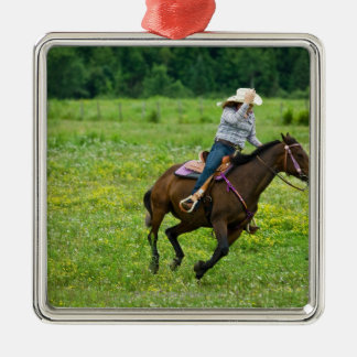 Horseback rider galloping in rural pasture Silver-Colored square decoration