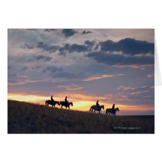 Horseback riders at sunset 2 card