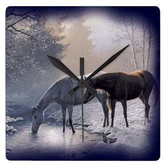 Horses at winter stream Wall Clock