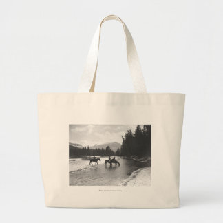 Horses drinking from and crossing a river canvas bag