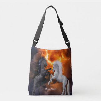 Horses fighting in a bad lightning storm crossbody bag