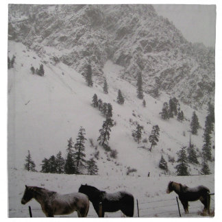 Horses in the snow in the mountains napkin