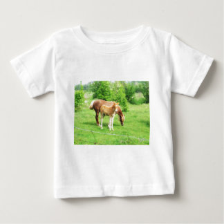 Horses relaxing in the field baby T-Shirt