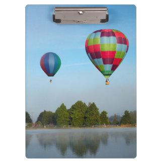 Hot air balloons over a lake,  NZ Clipboard