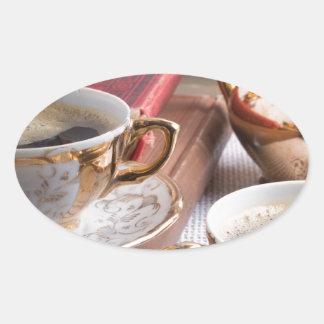 Hot coffee and retro crockery for breakfast oval sticker