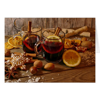 Hot mulled wine glasses in Christmas decoration Card