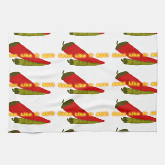 Hot Peppers On White Towels