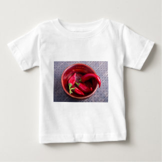 Hot red chili peppers on a fabric background baby T-Shirt