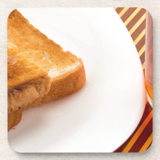 Hot toast with butter and cup of tea coaster