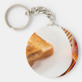 Hot toast with butter and cup of tea key ring