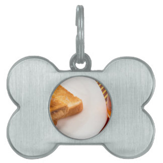 Hot toast with butter and cup of tea pet ID tag