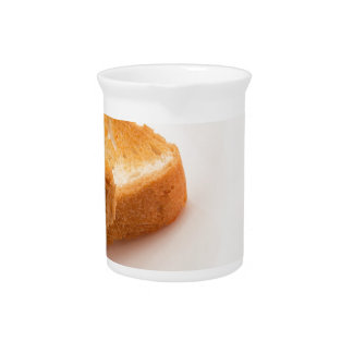 Hot toast with butter and cup of tea pitcher
