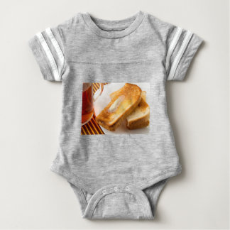 Hot toast with butter on a white plate close-up baby bodysuit