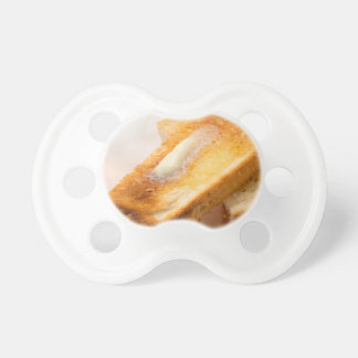 Hot toast with butter on a white plate close-up dummy