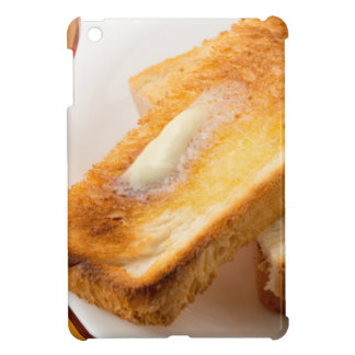 Hot toast with butter on a white plate close-up iPad mini cover