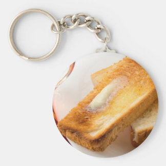 Hot toast with butter on a white plate close-up key ring