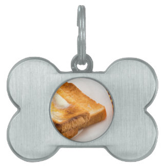 Hot toast with butter on a white plate pet ID tag