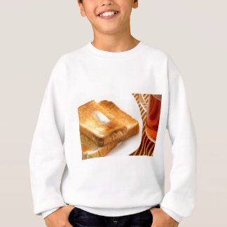 Hot toast with butter on a white plate sweatshirt