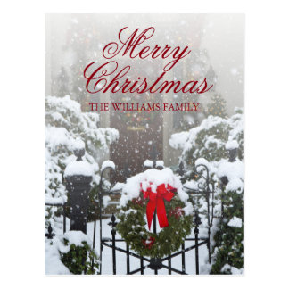 House door with Christmas wreaths and snow Postcard
