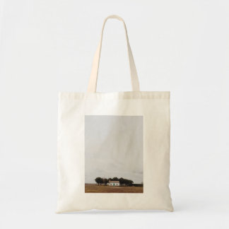 House guarded by several trees budget tote bag