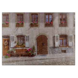 House in Gruyere village, Switzerland Cutting Board
