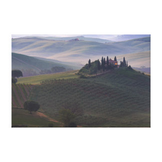 House in Tuscany in the morning fog canvas print