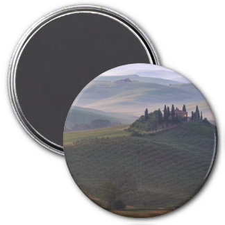 House in Tuscany in the morning fog round magnet