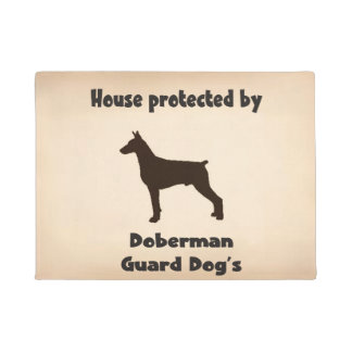 House protected by Doberman guard Dogs. Doormat