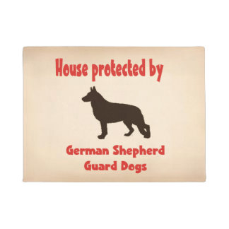 House protected by German Shepherd guard Dogs. Doormat