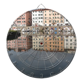 Houses and boats are reflected in the water dartboard