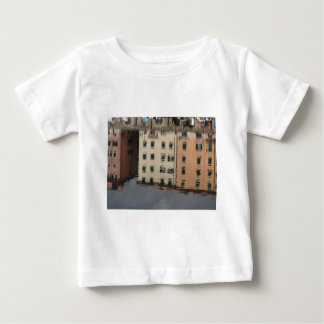 Houses are reflected in the tranquil water baby T-Shirt