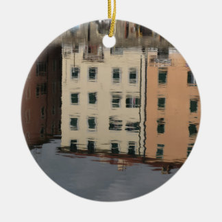 Houses are reflected in the tranquil water ceramic ornament