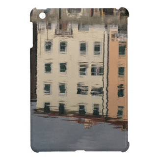 Houses are reflected in the tranquil water iPad mini cover