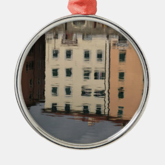 Houses are reflected in the tranquil water metal ornament