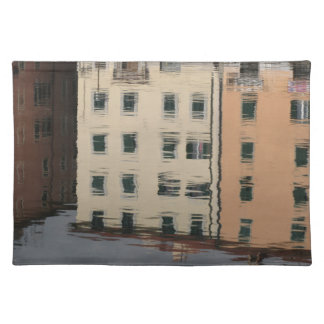 Houses are reflected in the tranquil water placemat