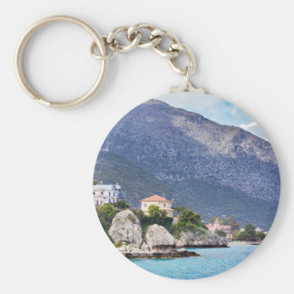 Houses rocks and mountain at greek sea basic round button key ring