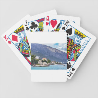 Houses rocks and mountain at greek sea bicycle playing cards
