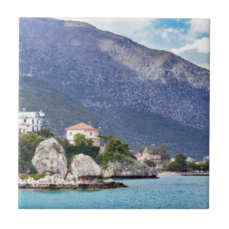 Houses rocks and mountain at greek sea small square tile