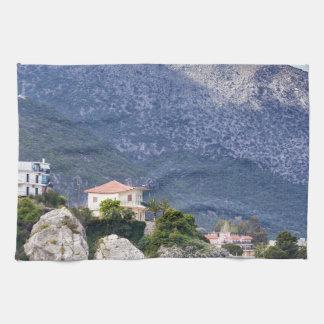 Houses rocks and mountain at greek sea tea towel