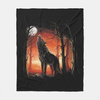 Howling Wolf at Sunset Fleece Blanket