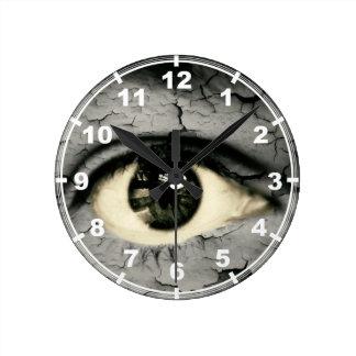 Human eye serrounded by Peeling skin Wall Clocks