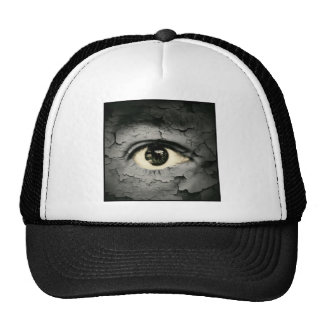 Human eye serrounded by Peeling skin Hats