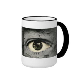 Human eye serrounded by Peeling skin Mug
