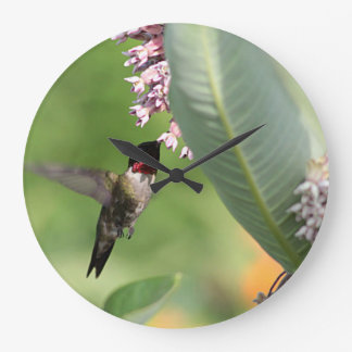 Hummingbird feeding on pink flowers large clock